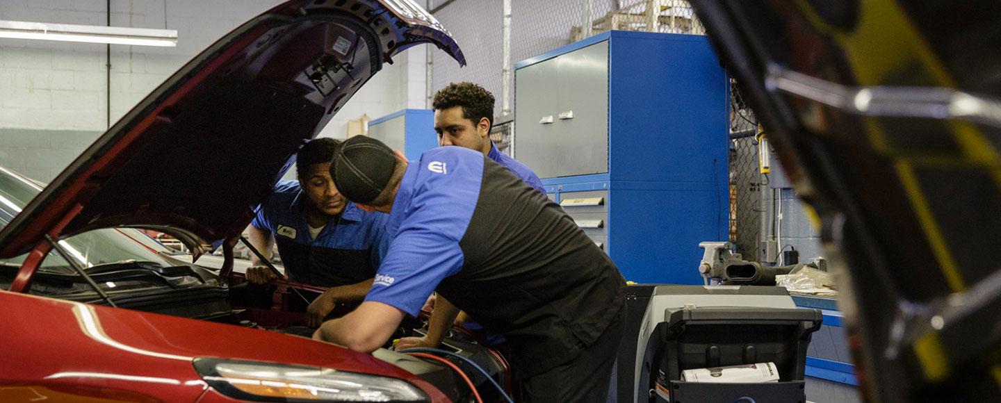 Automotive Technologyn Students under the hood