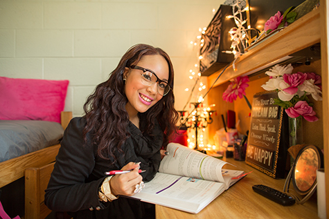 Student studying in her dorm room