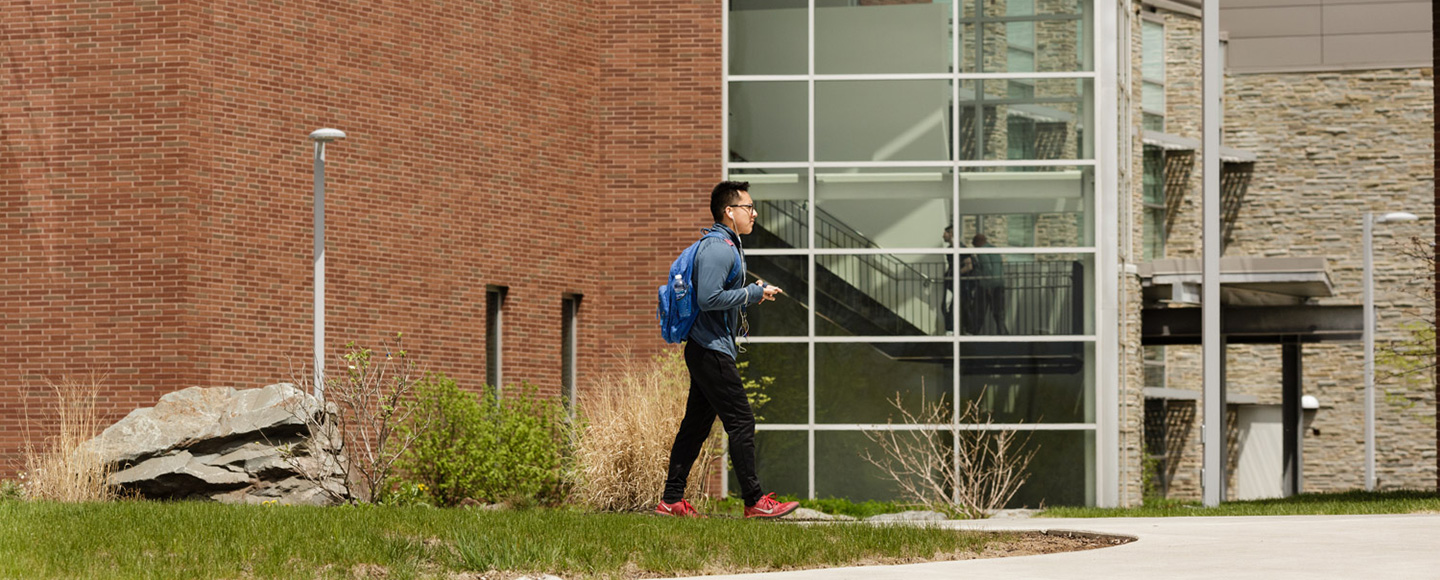 Student walking outside Monroe campus