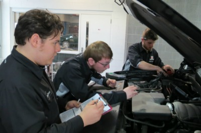 Auto tech interns perform a multi-point inspection