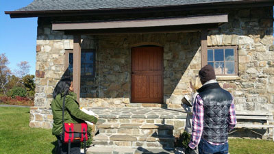 Once students from Karen Layton's science class had completed site checklists and studied topographic maps, it was time to go inside the Cattell Cabin to review and discuss the maintenance of the barrens community.