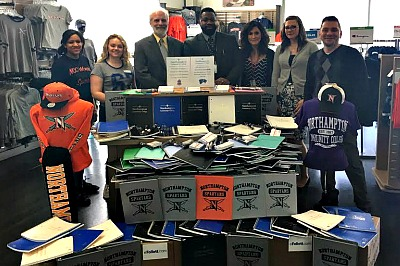 Dean Matt Connell and Dr. Mark Wade with NCC students and school supplies collected for Pocono Mountain West High School