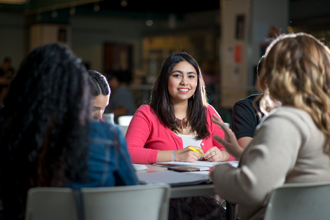 Students discussing at table