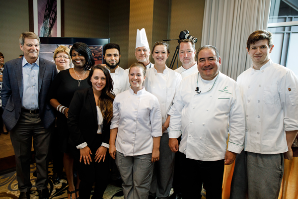 Chef Emeril with the winning hospitality and culinary students