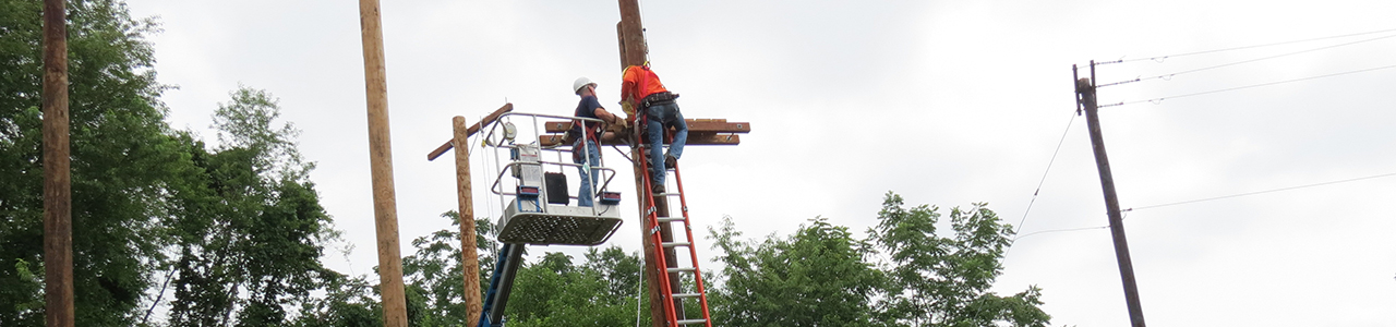 Lineworker training on telephone poles